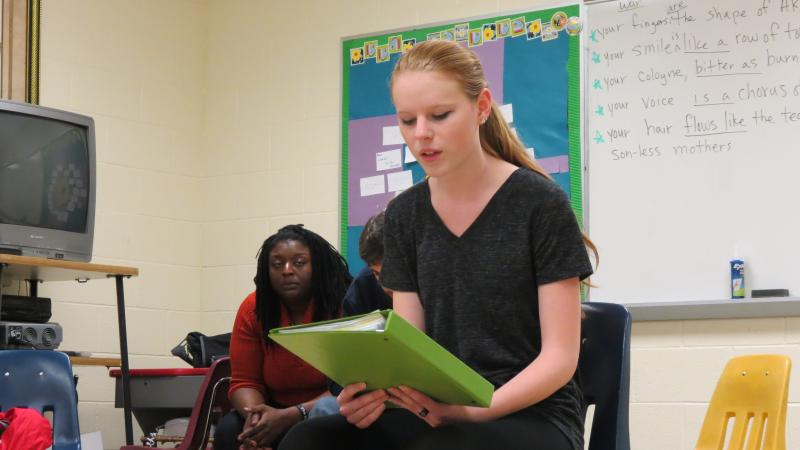 A Northwest School of the Arts student reads her poem about an eating disorder during the workshop.