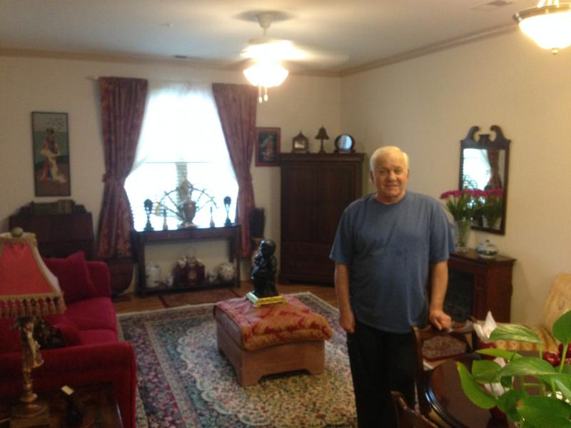 Renaissance resident Roger Hobbs shows off his living room