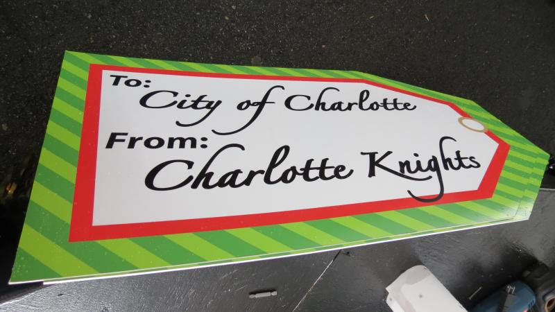 The gift tag that will be attached to the top of the box inside the Charlotte Knights snowglobe.