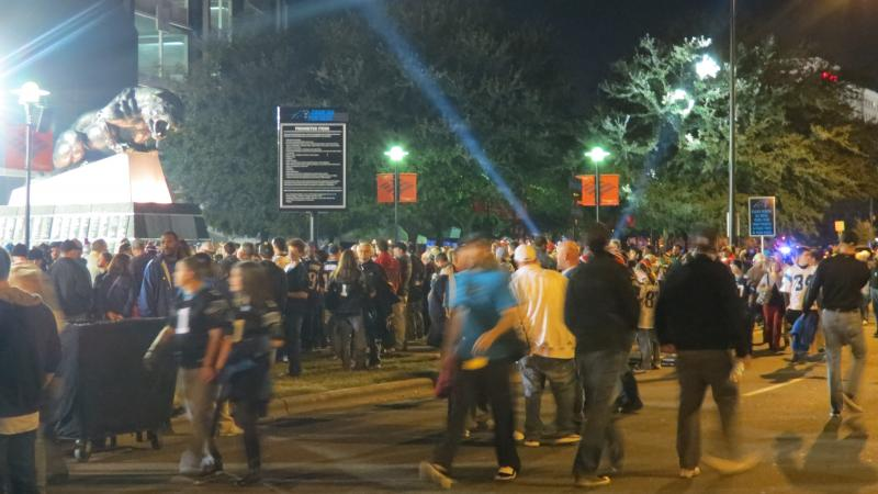 Fans stream into Bank of America Stadium.