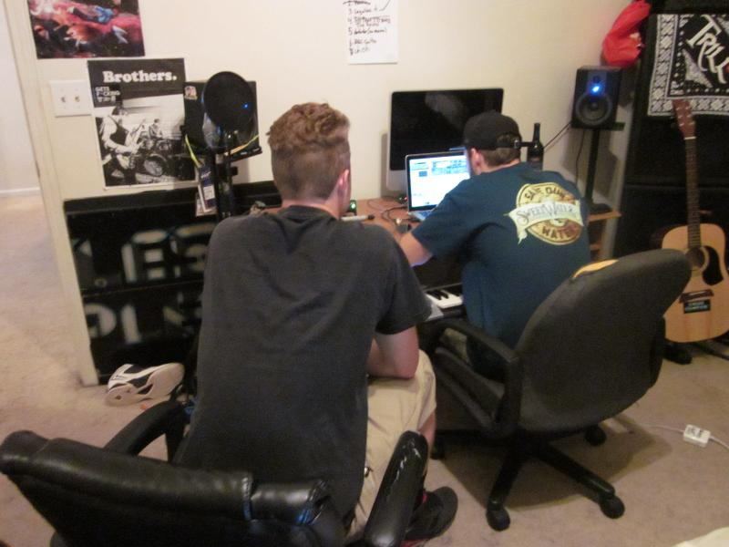 Alex Steins and Austin Hains work together on tracks in Alex's bedroom, their makeshift studio.