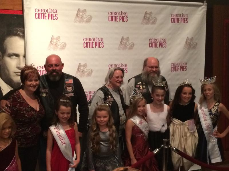 "Members of Guardians of the Children and local pageant particpants pose for pictures at the ""Bad Grandpa"" red carpet party."