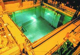 Spent nuclear fuel rods are often stored in large pools of water.