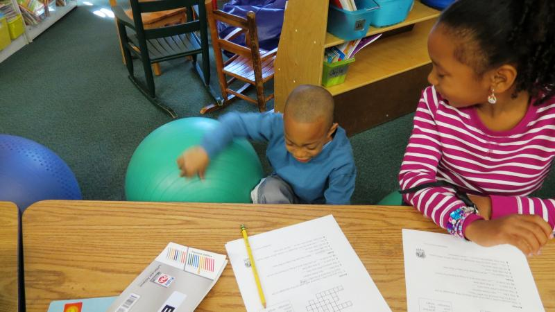 Kindergarteners Jayla Lashley and Sheldon Walker are working on a crossword puzzle together, when all of a sudden her reading partner, Sheldon, falls to the floor.