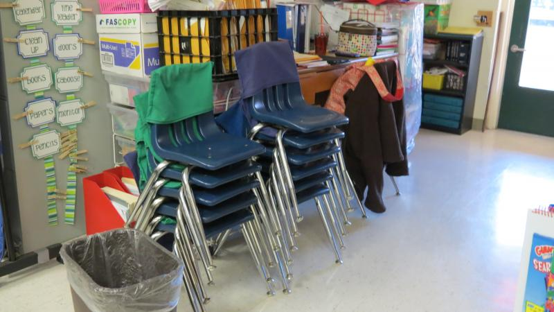 The chairs are stacked near the back of the classroom. Students can switch between balls and chairs at any time.