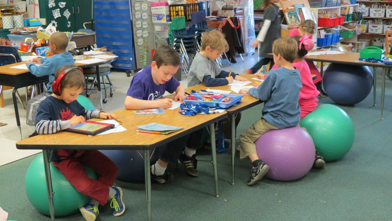 Students in Mrs.Denise Addison's K-1 class at Davidson Elementary work on iPads and crossword puzzles after reading a book called The Three Wishes.