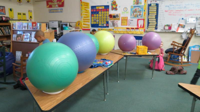 When not in use, the stability balls are kept in place on top of tables with paper plates.