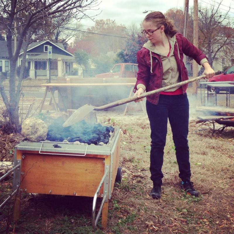 Courtney Blake tending the cook-fire before a creative gathering.