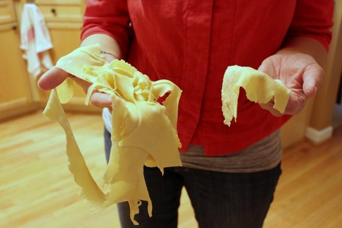 Scraps of pierogi dough that will be left to dry and used as noodles.