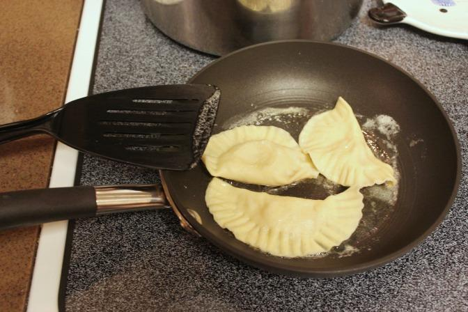 Frying the pierogi in butter, the finishing touch.