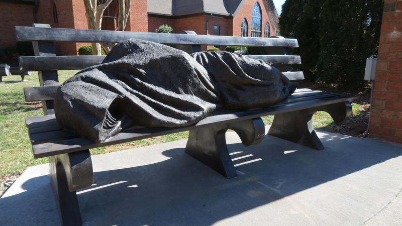 """Homelesss Jesus"" sculputre in front of St. Alban's Episcopal Church in Davidson."