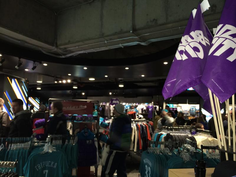 Buzz City flags hang over the Hornets merchandise in the Bobcats' team store