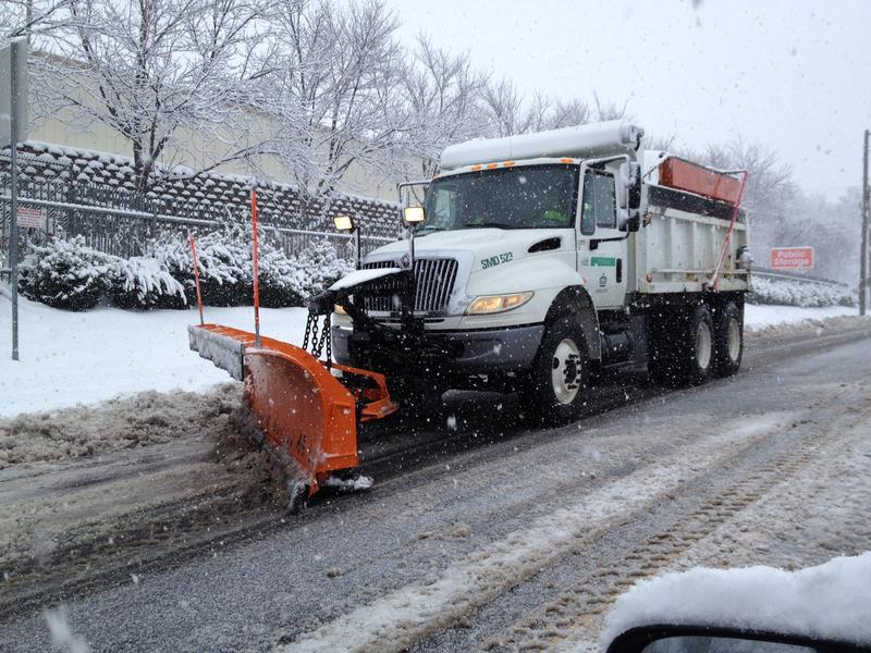 Snowplow on Tryon Street North of uptown.