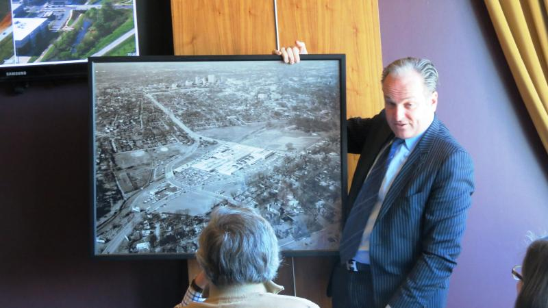 During the lunch at Dressler's, Brian Roth of Pappas Properties shows off a photo of Charlotte in 1959.