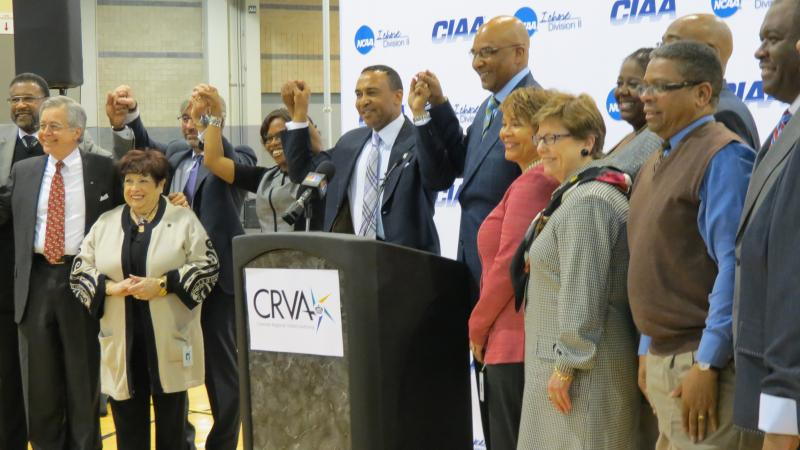Mayor Patrick Cannon holds hands with CIAA officials and city council members after the announcement that the CIAA would hold its tournament in Charlotte for six more years.