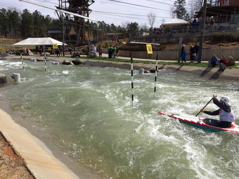 Another racer competes at the slalom trials at the U.S. National Whitewater Center.