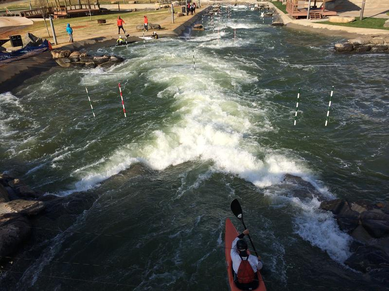 An athlete practices at the U.S. National Whitewater Center before the USA Canoe/Kayak National Team Trials.