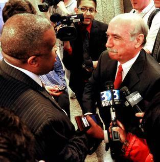 State Sen. Dan Clodfelter, right, talks with Charlotte City Council member David Howard, left, after Clodfelter was appointed to fill the remainder of former Mayor Patrick Cannon's term.