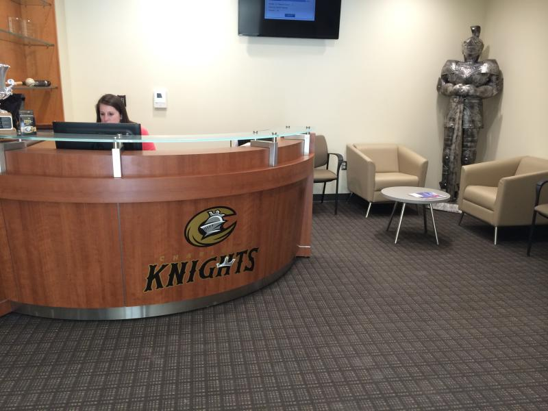 The Knights' office has a medieval knight standing in the corner.