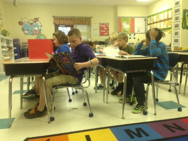 Once students complete a porfolio test, they can read quietly at their desks.