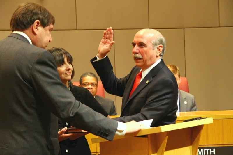 Dan Clodfelter takes the oath of office at his swearing in ceremony