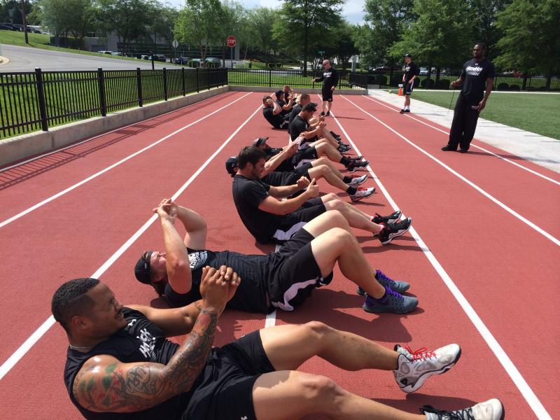The pit crews finish their workouts with situps.