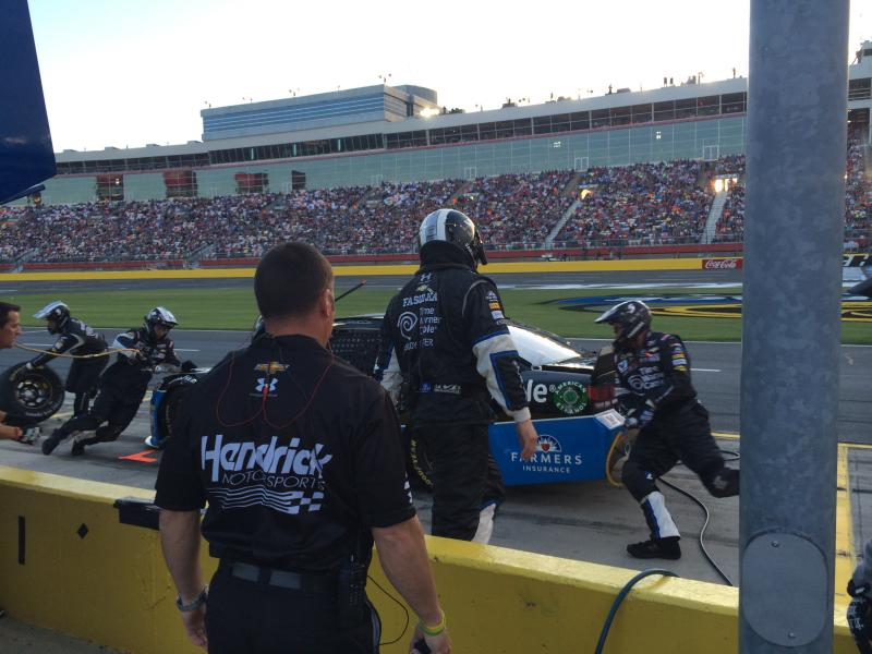 Coach Chris Burkey looks on during Kasey Kahne's pit stop during qualifying at the All-Star race.