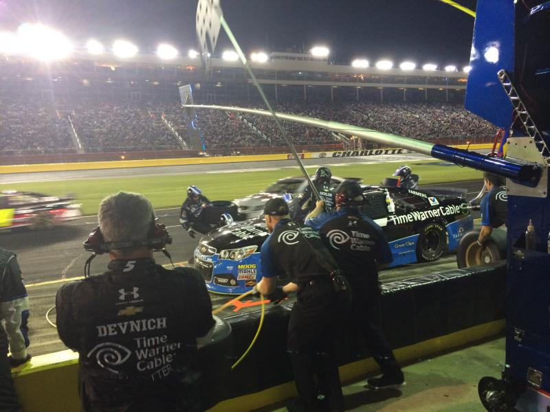 Kasey Kahne's pit crew sprints around Kahne's car during a pit stop at the All-Star race.