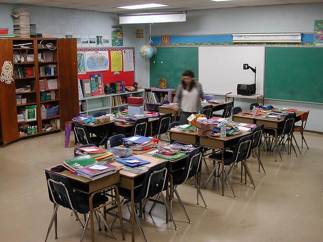 A teacher prepares a classroom.