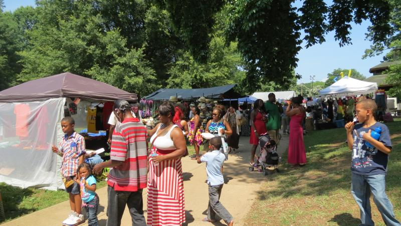 Visitors shop along what organizers call Black Wall Street during the Juneteenth festival.