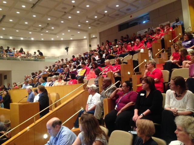Teachers and parents attended a public hearing to show their support of a raise for CMS employees paid for by the county.