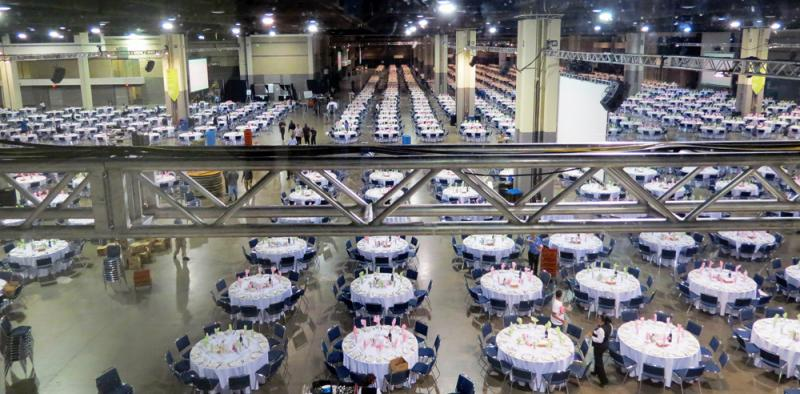 One thousand tables are arranged in the Charlotte Convention Center for the dinner.