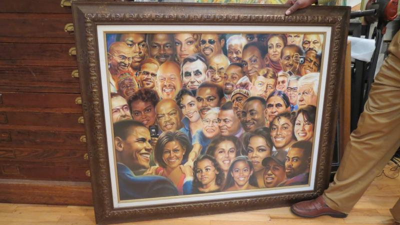 McJunkins still spends a lot of time sketching portraits at the mall and for special events. This piece is called Famous People of Clay.