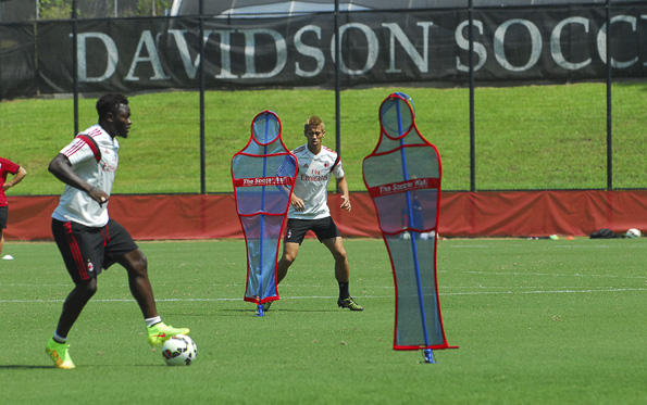 Michael Essien (left) and Keisuke Honda kicked the ball as AC Milan practiced Monday at Davidson College's Alumni Stadium.