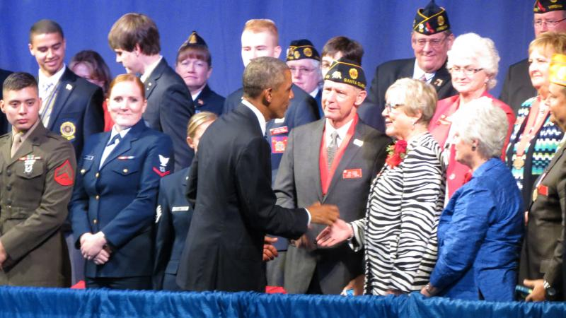 President Obama shakes hands with people in the audience after delivering his address.