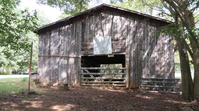 The goats and chickens stay inside the original pole barn on this farm from the 1950s.