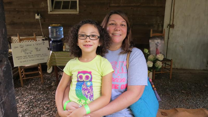 Seven-year-old Laylah Hunt and her mom, Cindy Hunt, are visiting from Stanley. They're planning to start their own farm in Gaston County.