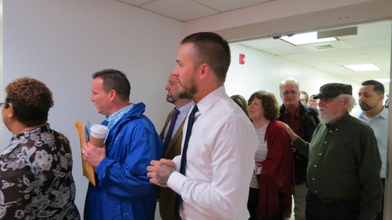 Couples file into the office on Monday morning to get their marriage licenses.