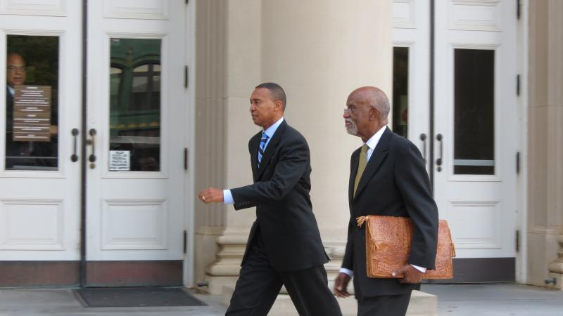 Former mayor Patrick Cannon walks out with his attorney James Ferguson after he was sentenced.