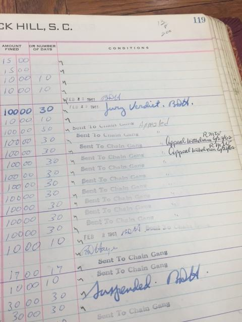 1961 court docket showing members of the Friendship 9 being sentenced to a chain gang.