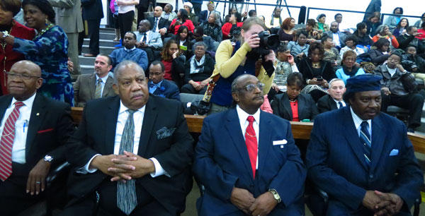 Friendship 9 members wait patiently for their hearing to begin in a packed courtroom. 54 years ago, they were arrested and served 30 days on a chain gang for staging a sit in at an all white McCrory's lunch counter