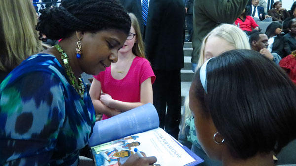 Kimberly Johnson, author of a children's book about the Friendship 9, No Fear For Freedom, signs a copy for Elise Headley.
