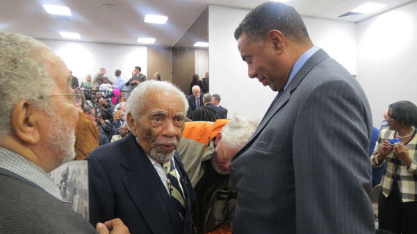 Former SC Chief Justice Ernest Finney and his son mingle before the Friendship 9 hearing begins in Rock Hill, SC