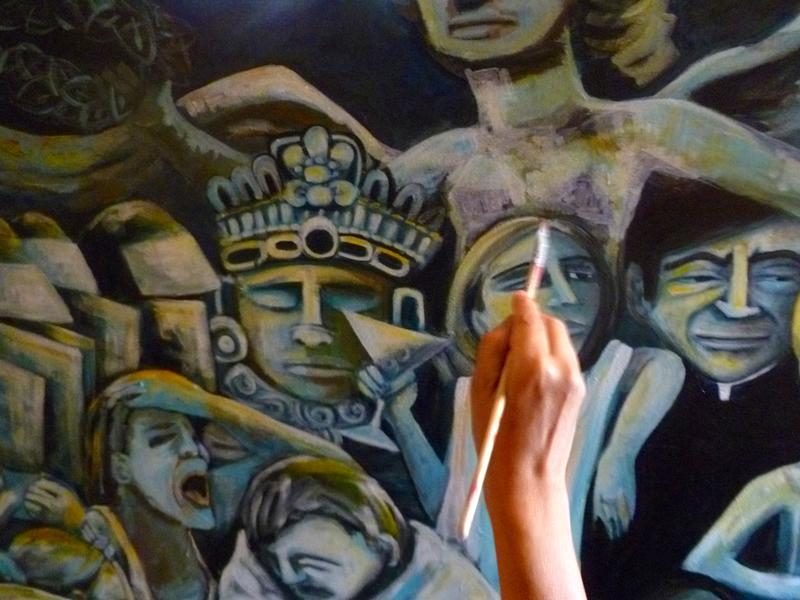 Rosalia Torres-Weiner applies a brushstroke to a painting that represents American deportation of undocumented  Latino immigrants.