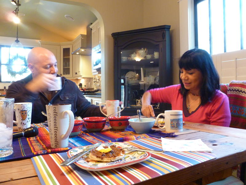 Torres-Weiner and her husband, Ben Weiner, during breakfast at their home in Commonwealth Park in Charlotte. The two have been married for 20 years.