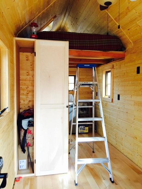 Loft bed and closet. The kitchen and bathroom are behind the ladder.