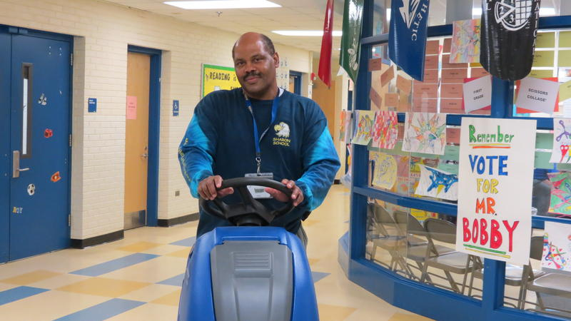 Sharon Elementary custodian Bobby Miller's day beings at 6 a.m. cleaning the school's floors with a mobile scrubber.