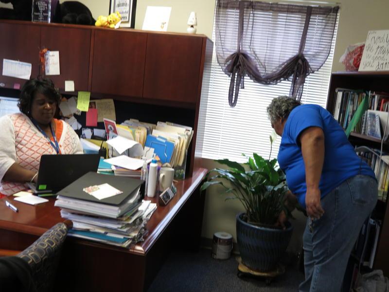 Barbara Watson takes care of principal Natashia Pegram plants. Watson is a national finalist for Cintas Corporation's janitor of the year award.