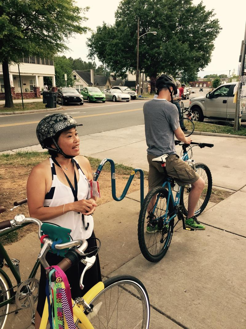 Pamela Murray greeting cyclists.