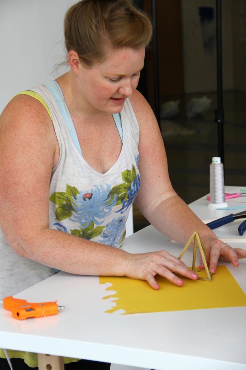 Artist  Kathryn Godwin working in her studio space in the Goodyear building.